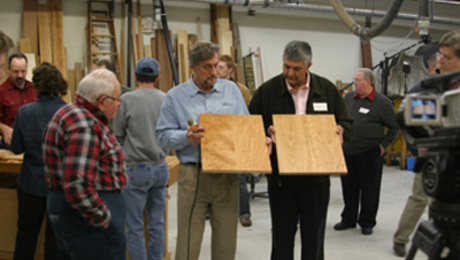 Anatole Burkin (L) compares tabletops with a Fine Woodworking reader at the end of the event.