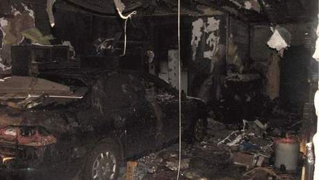 Damage from fire ignited by oil-soaked rags in the workshop.