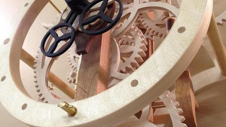 "Close up view of ""Remonter"" illustrating the clock hands and a mish mash of gears."