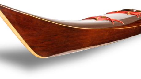 This sea kayak is constructed of Western Red Cedar with a cordovan mahogany stain. The wood is covered with 4 ounce fiberglass on the outside and 6 ounce carbon-Kevar cloth on the inside. The finished weight is 40 lbs.