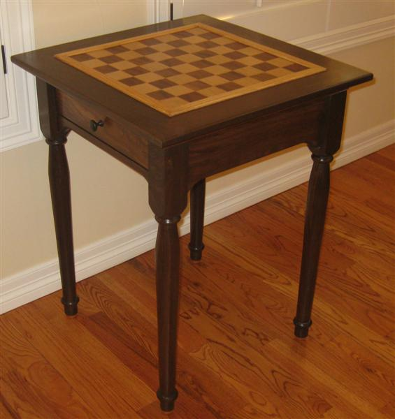 Walnut case with a walnut/maple/oak inlay chess table top.