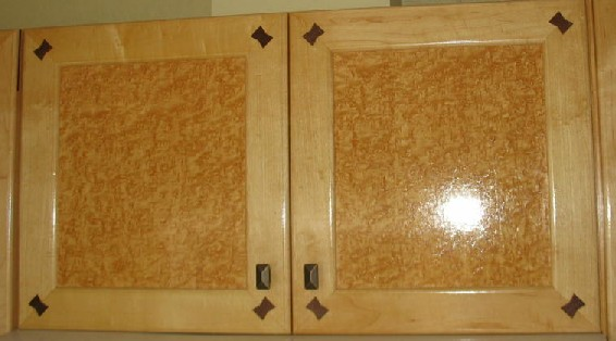 Bird 39 s eye maple cabinets with walnut joinery accents for Birdseye maple kitchen cabinets