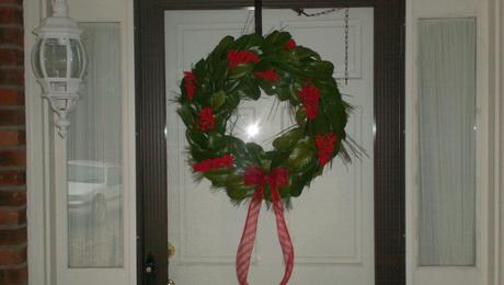 My departed grandmother taught me how to make homemade Christmas wreaths since she never could afford one. You basically take a straw wreath and use floral pins to cover it in pine needle clumps. I then come back with magnolia leaves to cover the pine. I finish it off with clumps of real holly and a red bow and give to my friends at Christmas.