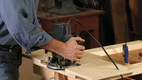 David Lehman using a self-centering mortising jig. For more, read the full article on how to make it.