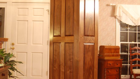 Back and side showing walnut bookmatched raised panels