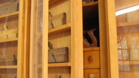 Using the cabinet doors to hold and display my antique plane collection.