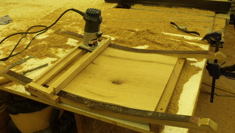 Here is the basic carriage. Note that I chose to use my laminate trimmer with a cove cutting bit.  Also, the router is boxed into the carriage to eliminate unwanted movement.