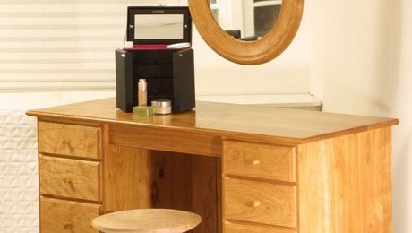 Cherry vanity desk with matching turned stool and turned mirror frame.