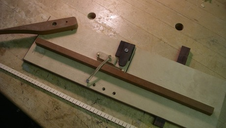 kerfed lining jig and piece of finished lining. Materials are scraps from around the shop. Mahogany, Ebony and Rosewood.