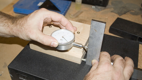 First square the jig by pushing it against a good quality square and set the dial to zero.