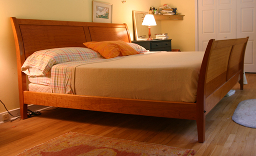 This bed was for a friend whose only request was that is was comfortable to  read in. The panels are coopered quartersawn cherry.