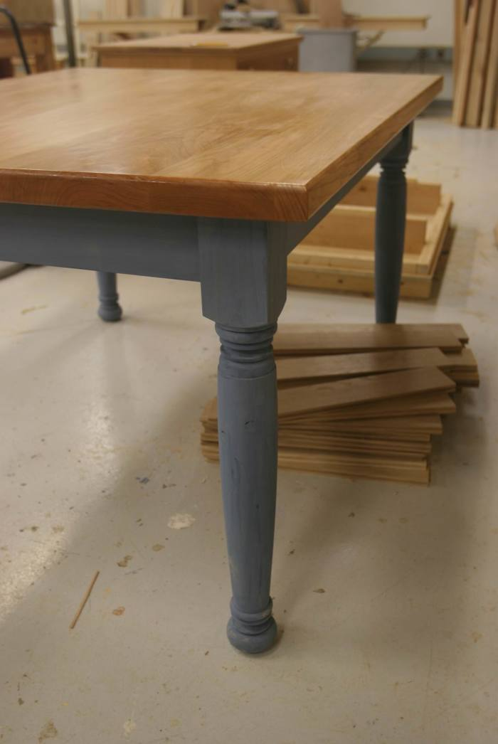 This Farmhouse Table Has A 1.5u2033 Thick Solid Cherry Top Set On Prefab  (gasp!) Legs. Finish Is Milk Paint On The Base, Oil And Wax On The Top.