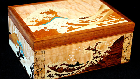 Multi-paneled marquetry jewelry box with interpretations of 18th century Japanese woodblock prints