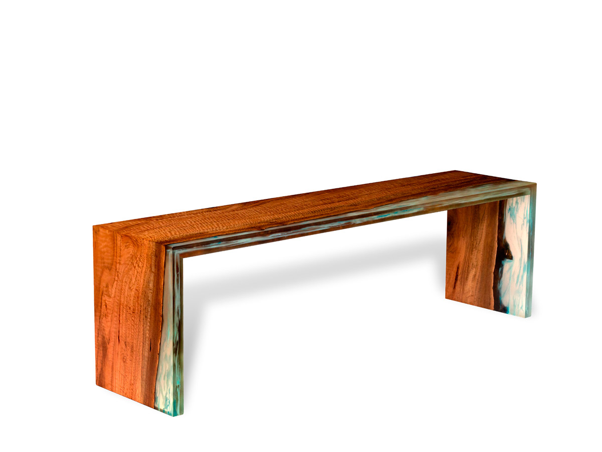 """Land, Water, and Air"" bench uses a slab from a 100-year-old eucalyptus along with resin and reclaimed steel"