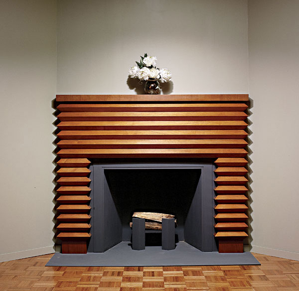 Woodworker: Mario Rodriguez The face of this mantel is made up entirely of triangular sections laid horizonatlly and wraapping neatly around the corners. Resting on top of unadorned plinths
