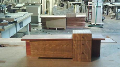 A shot of tansu cabinet during construction with the model on bench top in foreground.