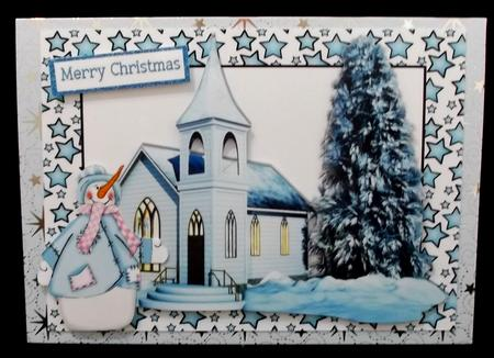 Church in the snow with snowman in blue star frame in Card Gallery
