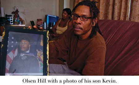 Olsen Hill with a photo of his son Kevin.