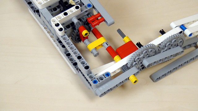 Image for Improving FLL Robot Game. Extend axles to reach from the motor to the wheels