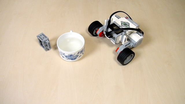 Image for EV3 Phi. Task - use wait when the cup is over the robot buttons