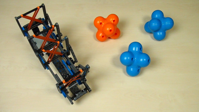 Image for VEX IQ Crossover. The math behind grabbing a hex ball with levers attached to gear wheels.
