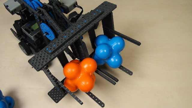 Image for VEX IQ Crossover. Task. Move objects with the TDF attachment and the gamepads