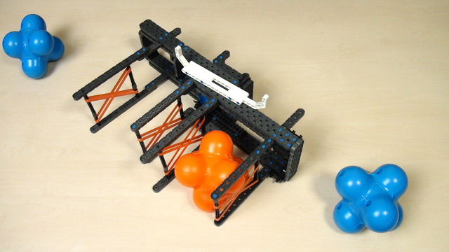 Image for VEX IQ Crossover. Task. Add the grabbing attachment to a robot