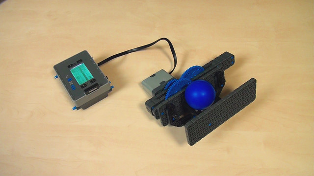 Image for VEX IQ. Throwing a ball by punching it with two levers