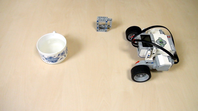 Image for EV3 Phi. Task - find the maximum speed without the cup falling from the robot