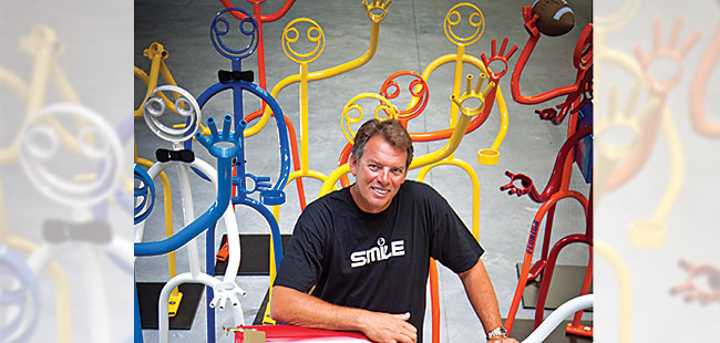 Stick figure sculptures are smiley-face business