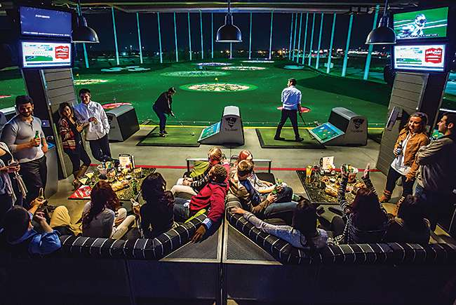 Driving for dough: Jazzed-up golf driving ranges are growing
