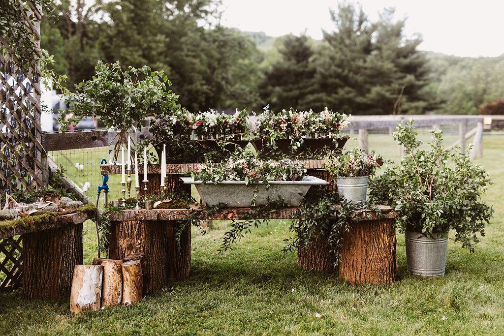 Wedding Planner and Florist KPW designs rustic barn table wedding flowers and and decor