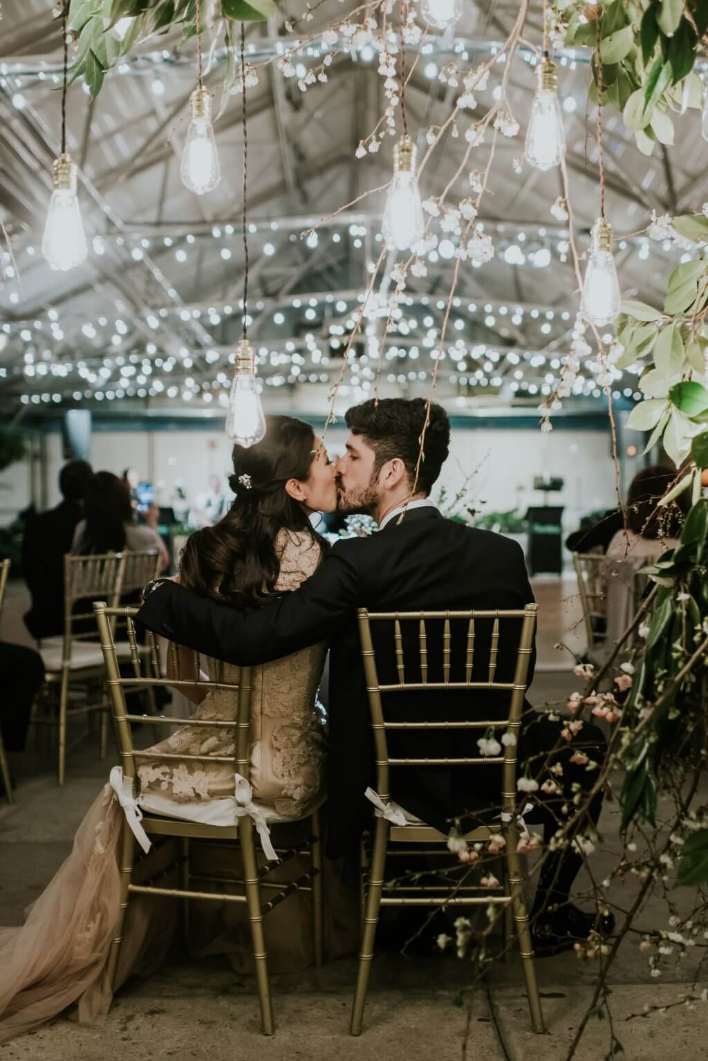 Bride and Groom kiss at Sweet Heart's Table at the Horticulture Center