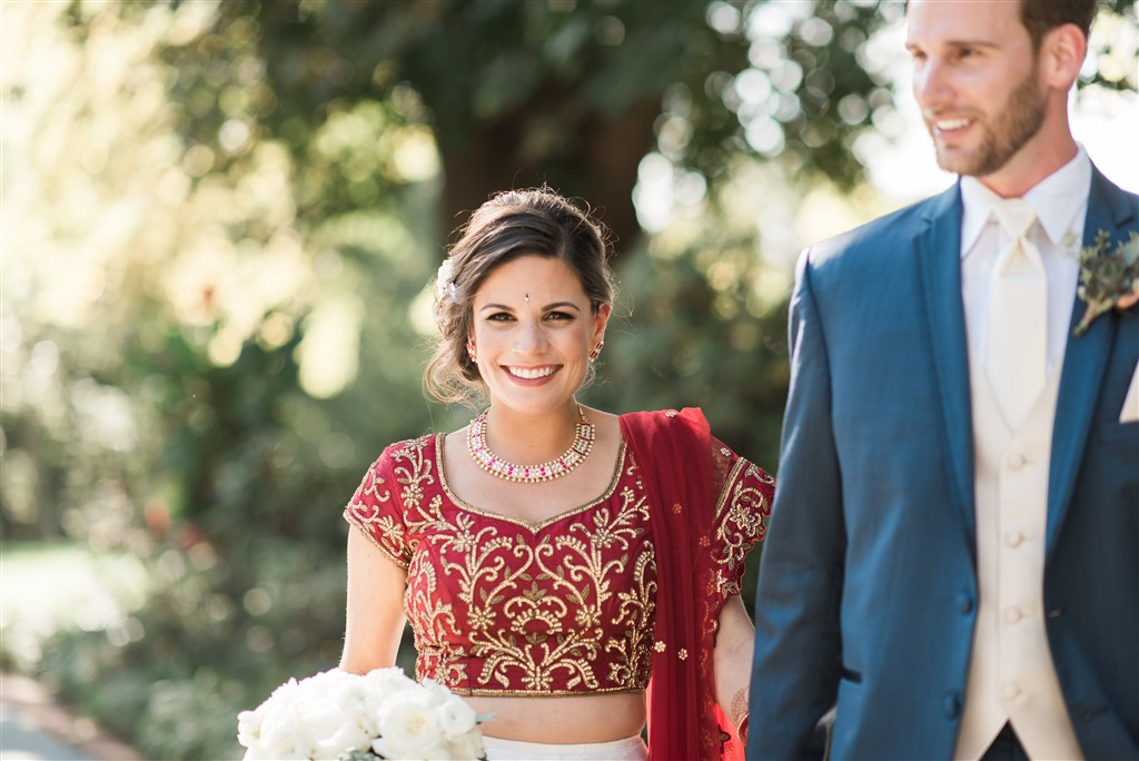 bride in traditional indian wedding dress groom in suit greenville country club wedding