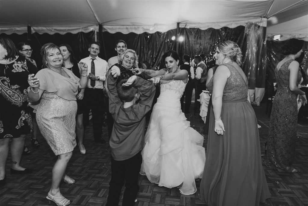 bride and guests dancing at greenville country club wedding