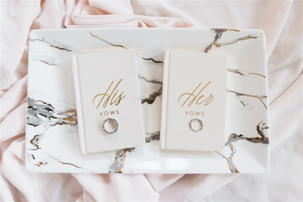 his and hers wedding rings on vows books by samantha jay photography