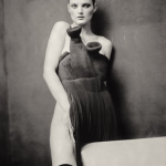Guinevere behind the table, 2004 by Paolo Roversi