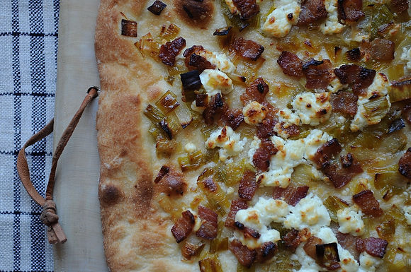Leek, bacon, and goat cheese pizza
