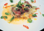 Citrus-seared tuna with crispy noodles, herbs and chilli Recipe
