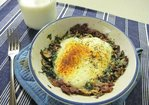 Parmesan baked eggs over bacon, mushroom, leek, and arugula hash Recipe