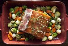 Applewood Smoked Bacon Rind Barded Pork Loin Roast with Fall Vegetables Recipe