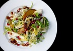Roasted Pear Salad with Endive, Pomegranate, Blue Cheese, and Hazelnut Vinaigrette Recipe