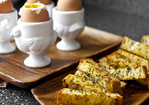 soft eggs with buttery herb-gruyere toasts Recipe