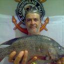 Foto de Tucunaré - o peixe e o pescador são do timão.