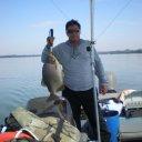 Foto de Pintado - pescaria de barco, apoitado no meio do rio parana, eu e um amigo, a correnteza estava forte por isso tivemos q. soltar o barco e rodar p/ poder embarca-lo