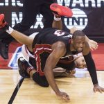 Wade, Heat beat Raptors in OT after Lowry's halfcourt heave