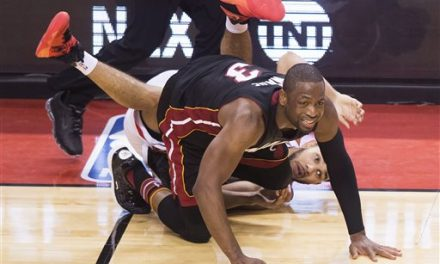 Wade, Heat beat Raptors in OT after Lowry's halfcourt heave