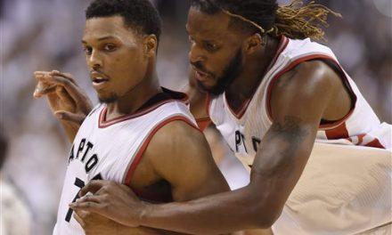 Carroll scores 21, Raptors beat Heat in OT to tie series