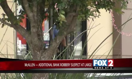 One of Two Bank Robbery Suspects behind Bars, another Remains on the Run