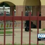 FOX 2 NEWS Exclusive:  Man Dangerously Sits on Roof of Building